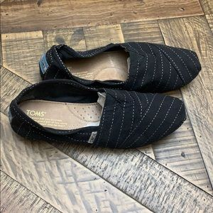 Toms color black with white stitching size 7.5